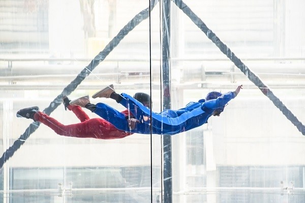 iFly Singapore skydivers in indoor wind tunnel, free fall simulator