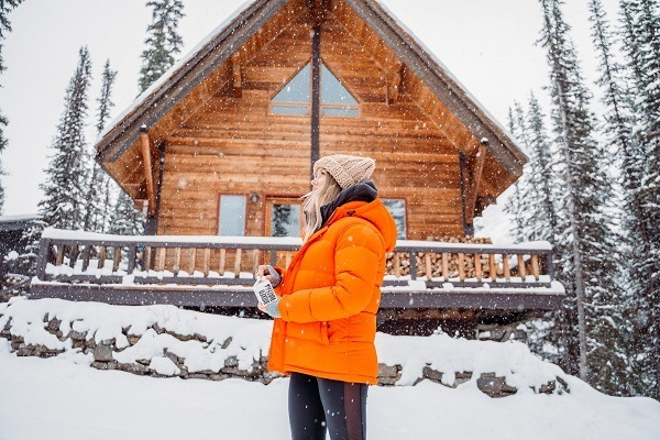 woman with ski jacket in snow